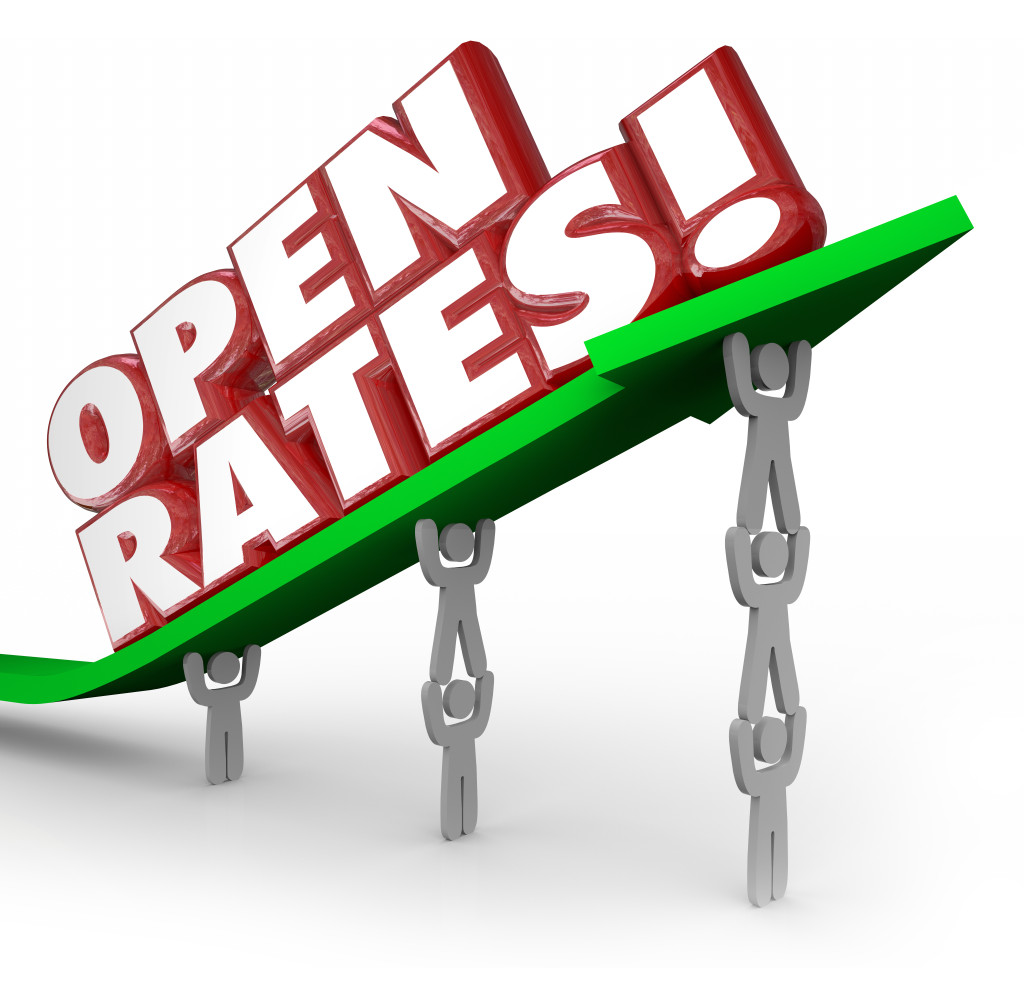 Open Rates red 3d words on an arrow lifted by a business marketing team aiming to increase successful efforts and campaigns targeting customers